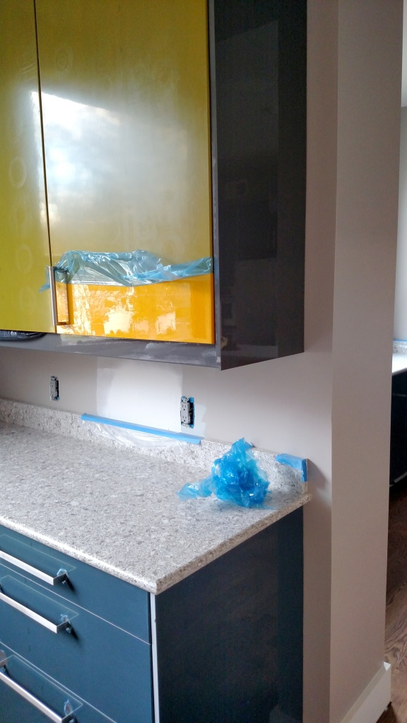 removing kitchen cabinet film